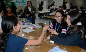 Foster Elementary students collaborate and problem solve to create and test science-themed challenges during Foster's annual STEAM Family Night on Jan. 30.