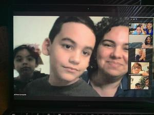 Boy with mom and sister on zoom
