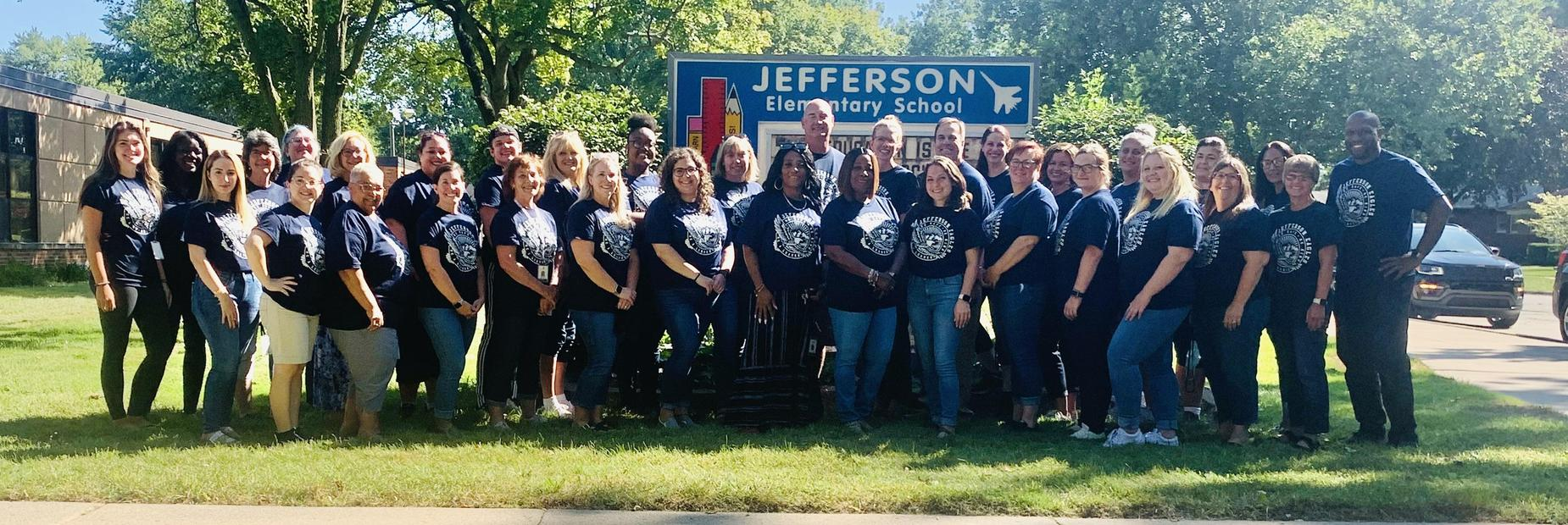 Jefferson Staff in front of the Jefferson Elementary School sign.