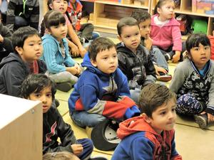 Preschool Students on floor listening to story