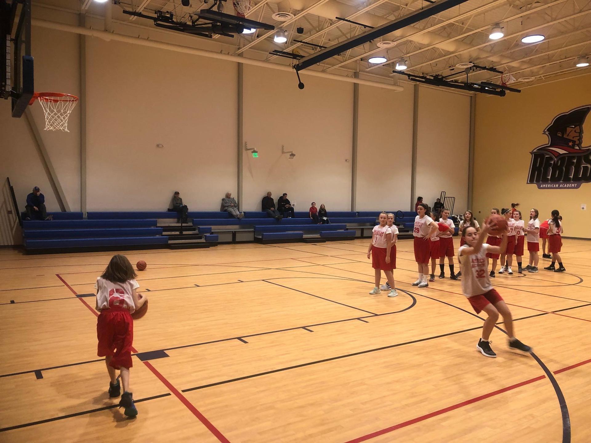 Girls basketball players warming up