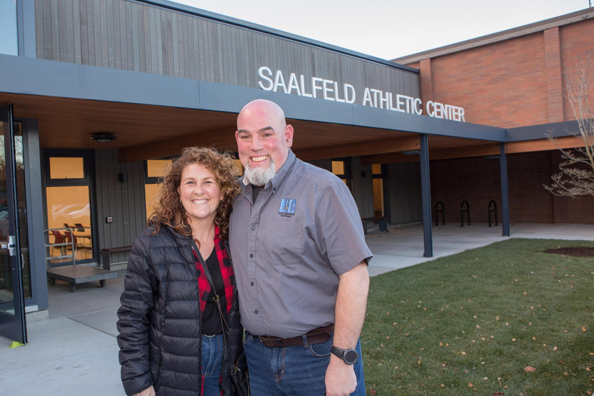 donors standing in front of Saalfeld Athletic Center main entrance