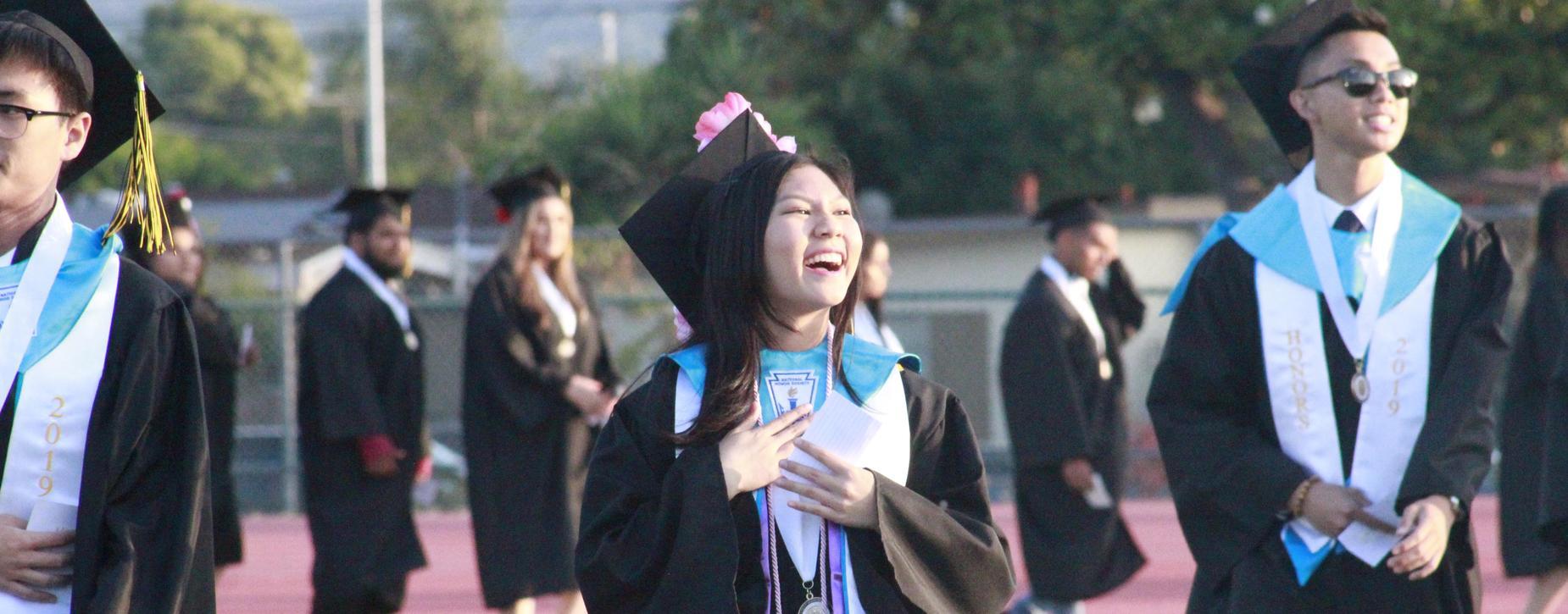 Female Graduate Student holding diploma