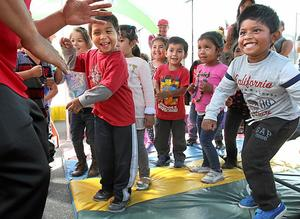 Danilo Mendez, 4, far right, and his Live Oak Elementary pre-k classmates get their groove on during a visit to the school by First 5 Express