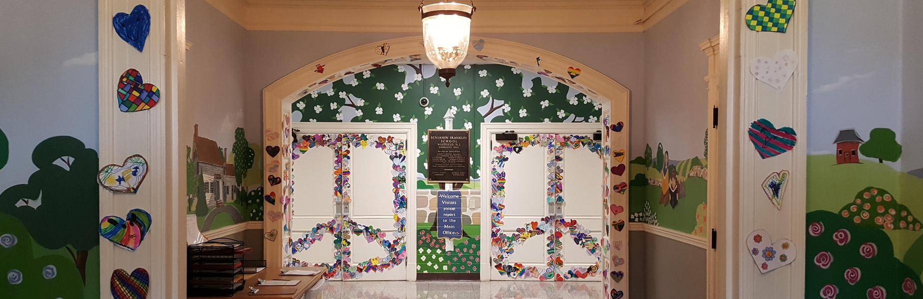 Each Franklin 5th grader created/decorated a paper heart with all hearts combined to create two large peace signs on the auditorium doors and elsewhere.