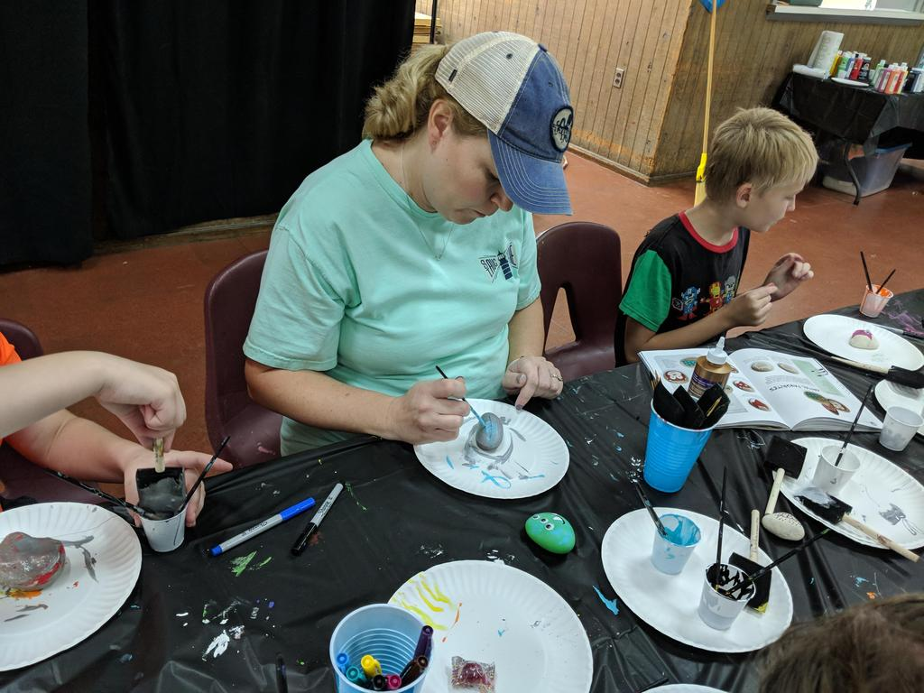 A day group is painting rocks