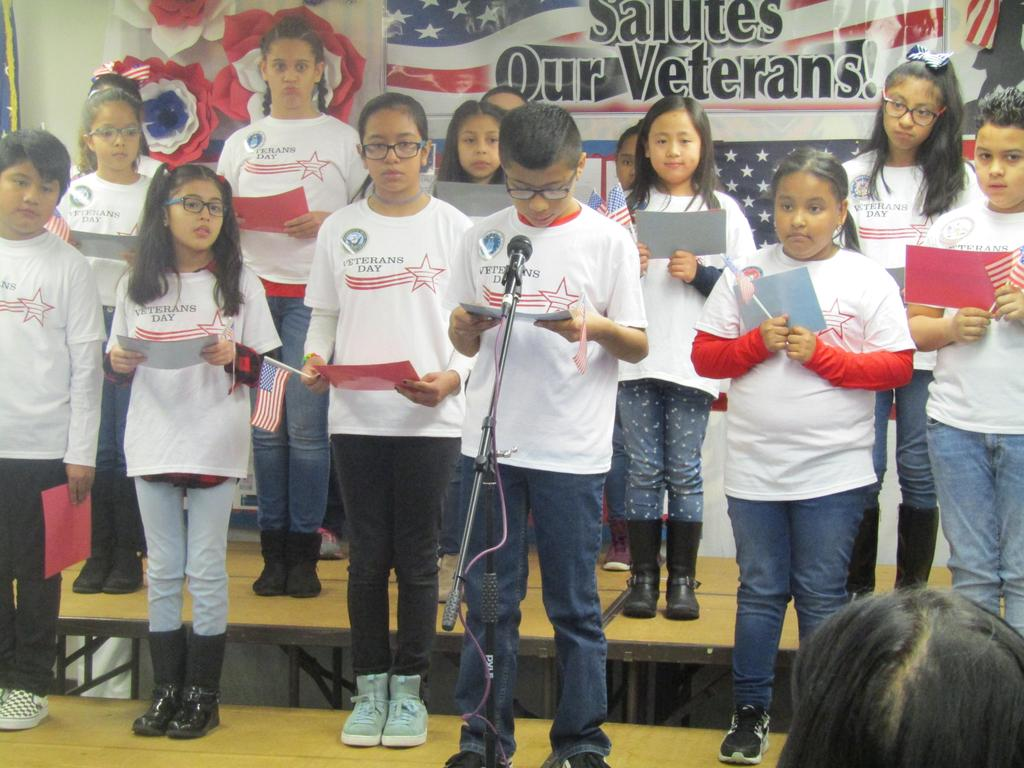 boy reading veterans poem at assembly
