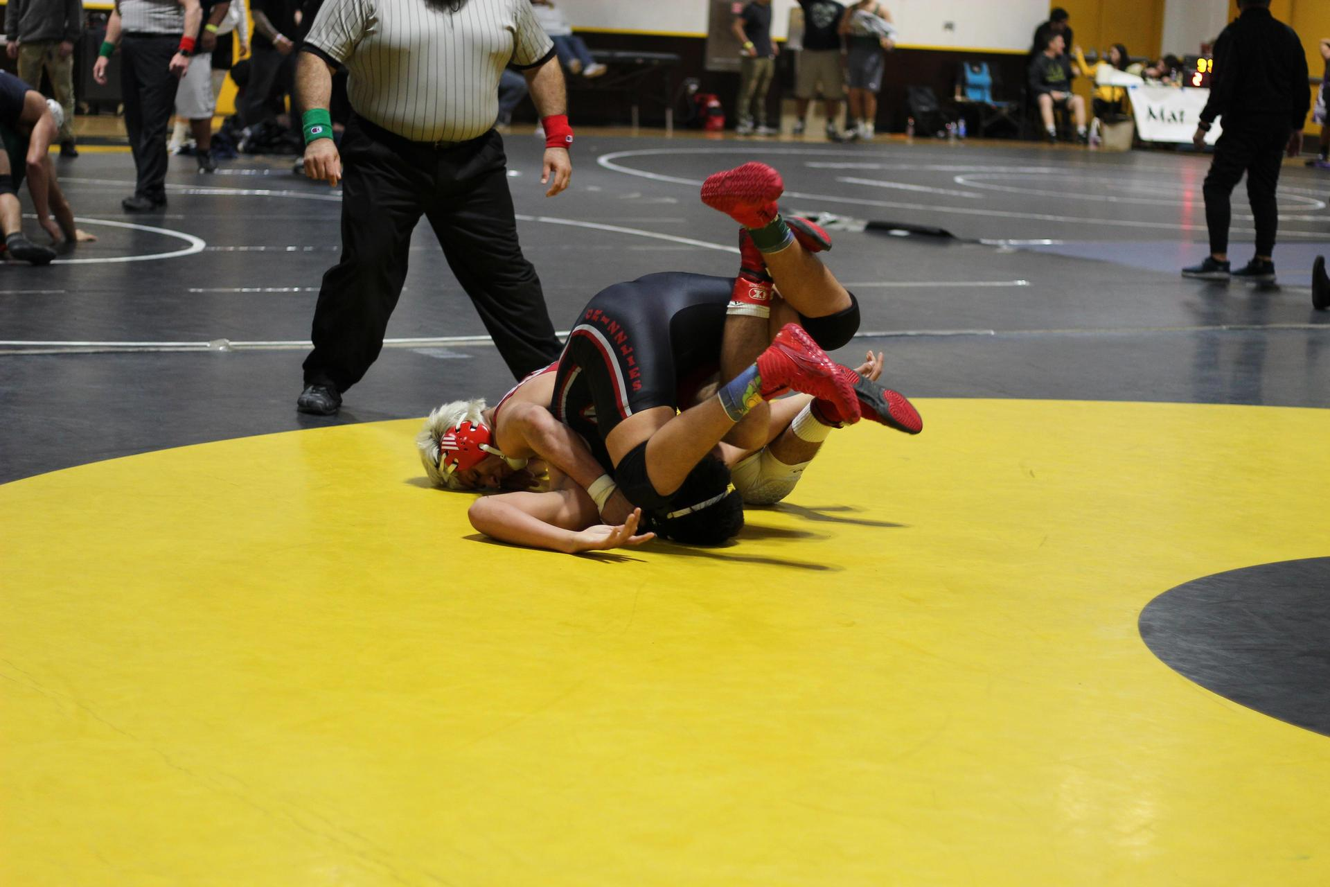 Chowchilla high wrestlers in action