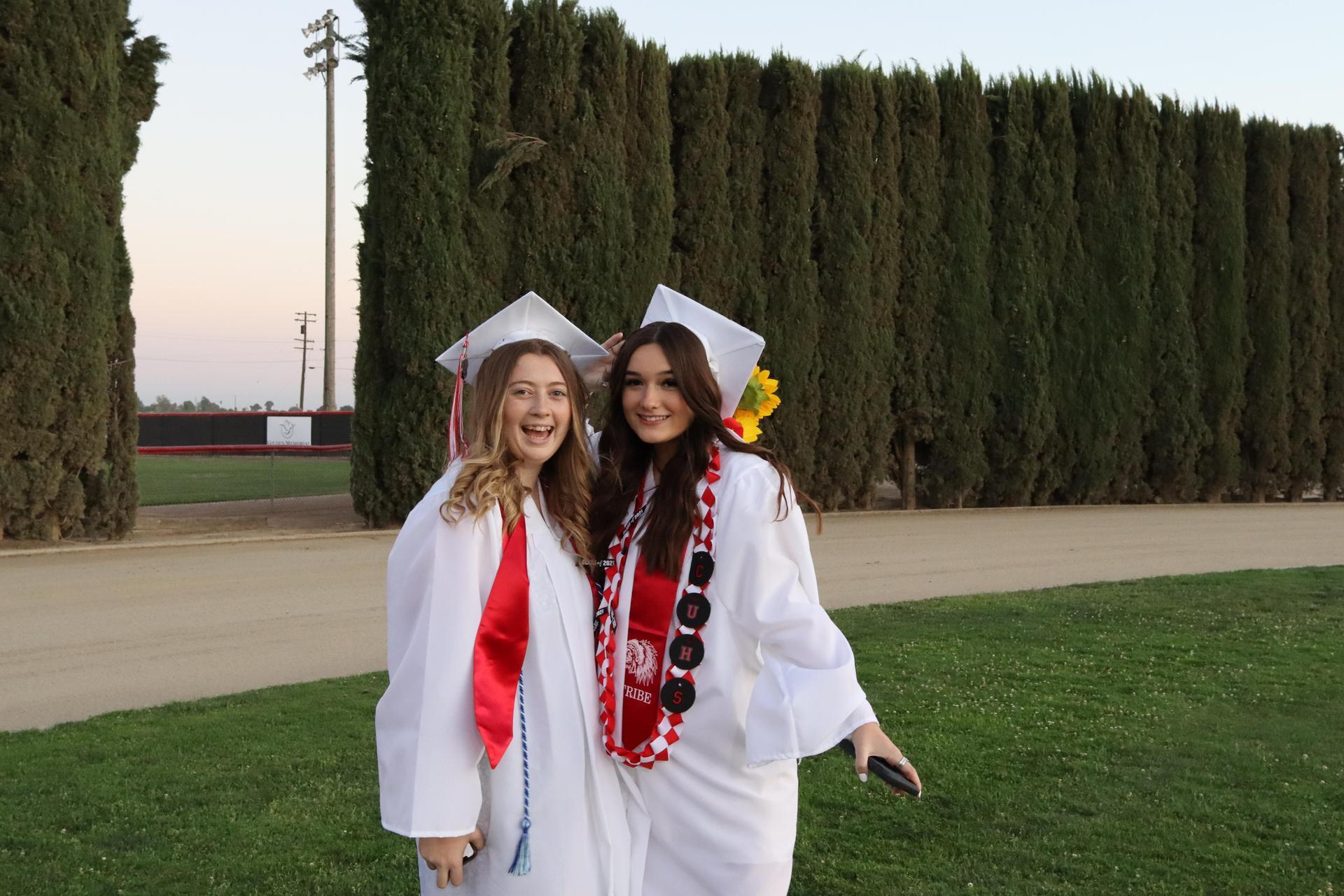 graduates walking in to graduation