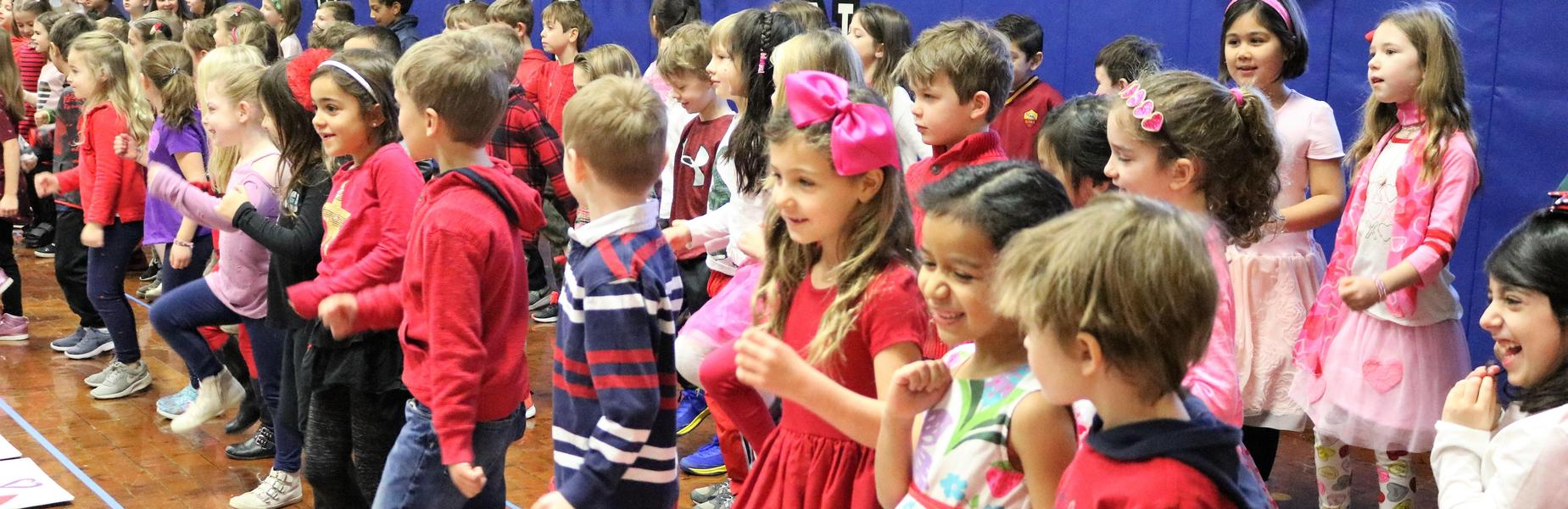 Photo of Wilson 2nd graders performing Valentine's Day concert for parents.