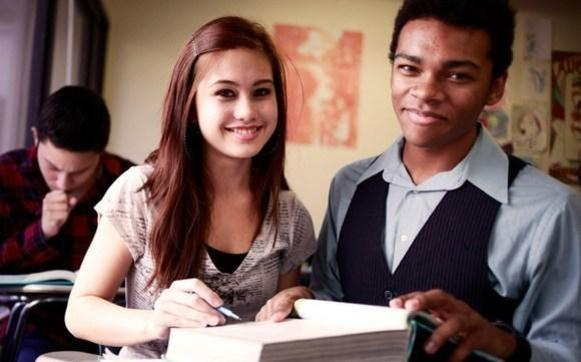 Two students with book