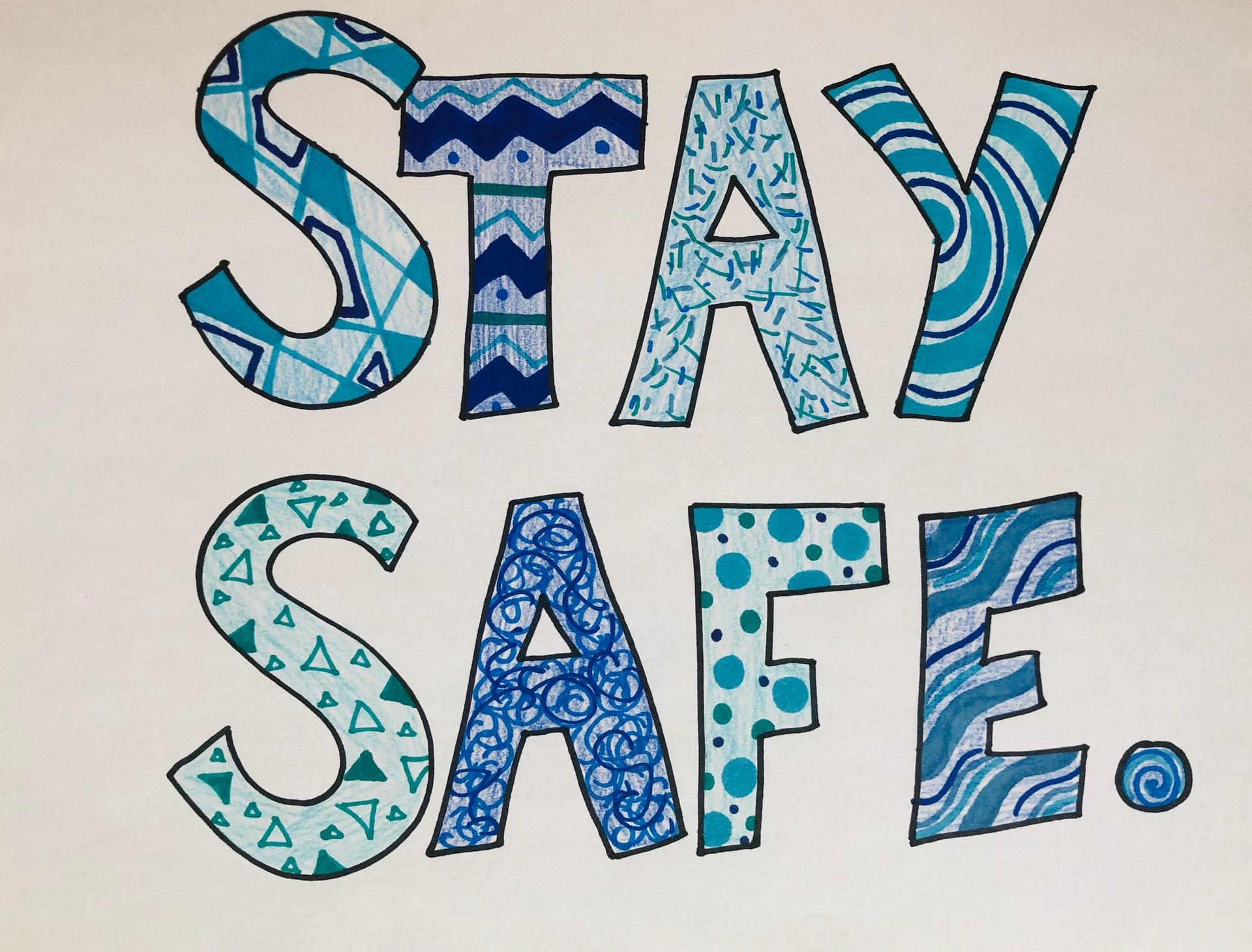 The words 'stay safe' filled in with various shapes, designs, and colors