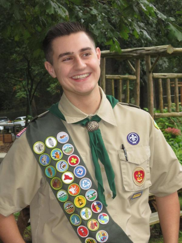 Former DDI student in Boy Scout uniform