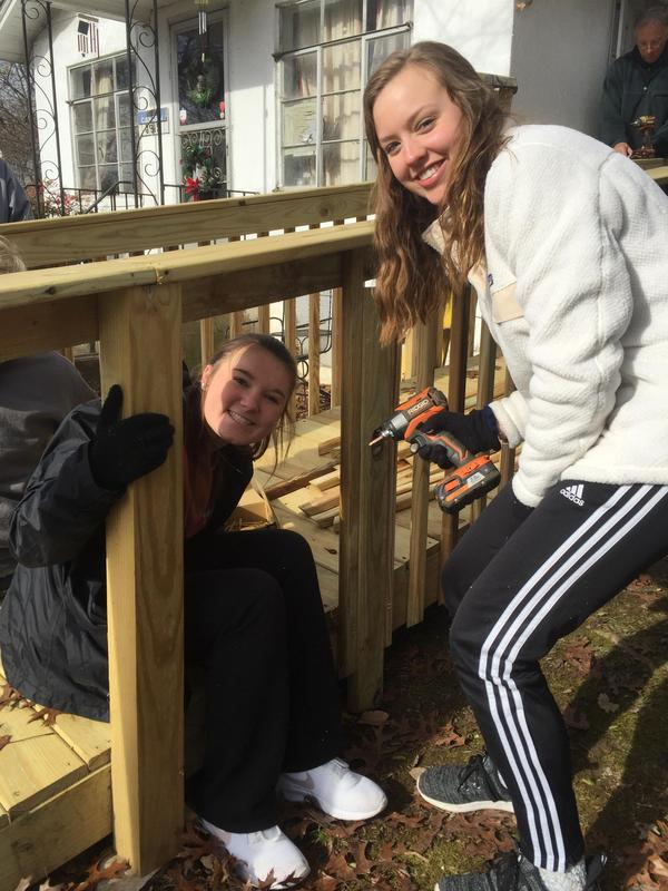 Students complete railing for wheel chair ramp