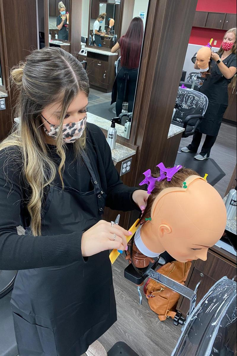 Cosmetology Student cutting hair
