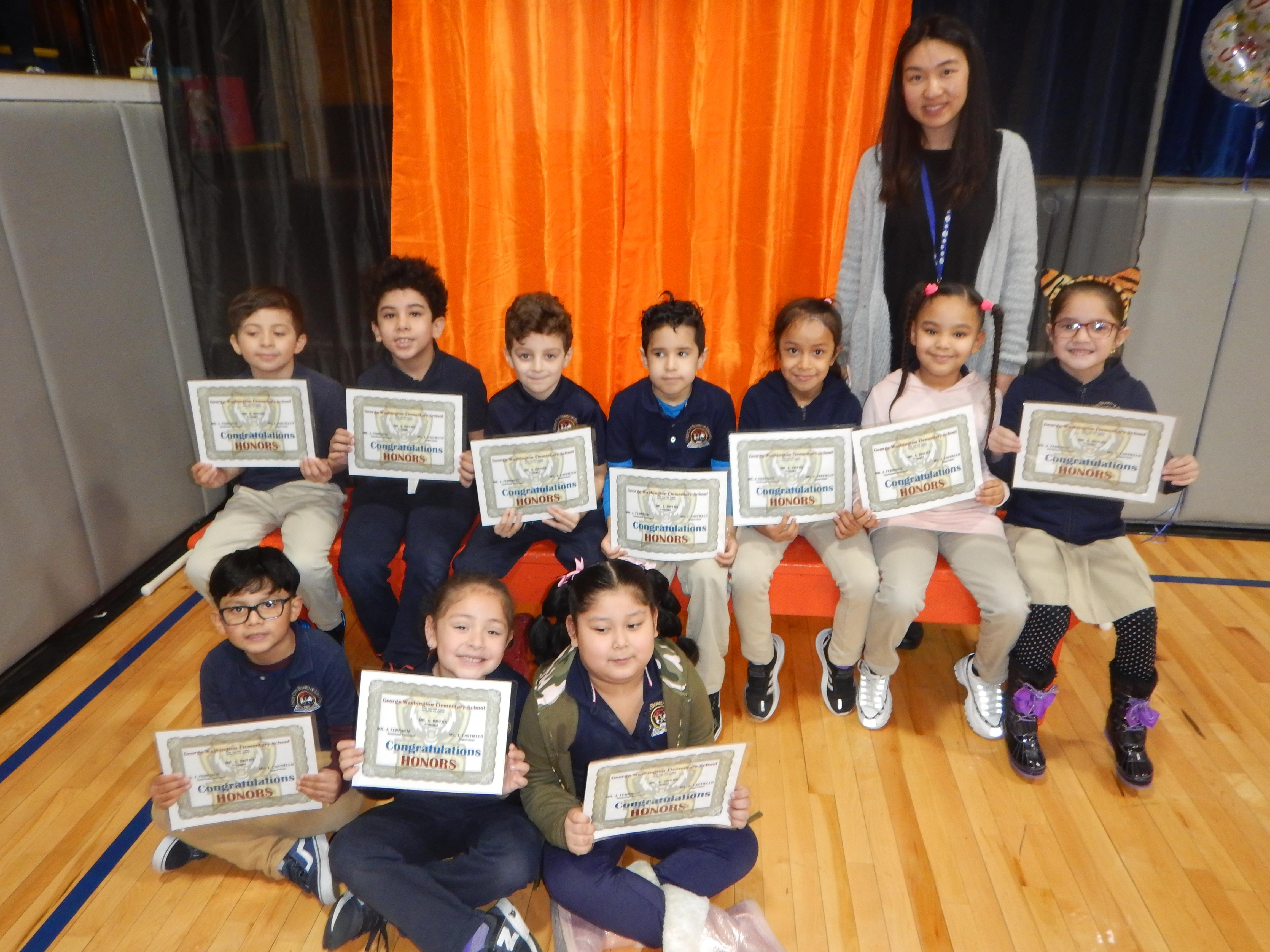 10 Honor Roll Students with their Teacher and certificates
