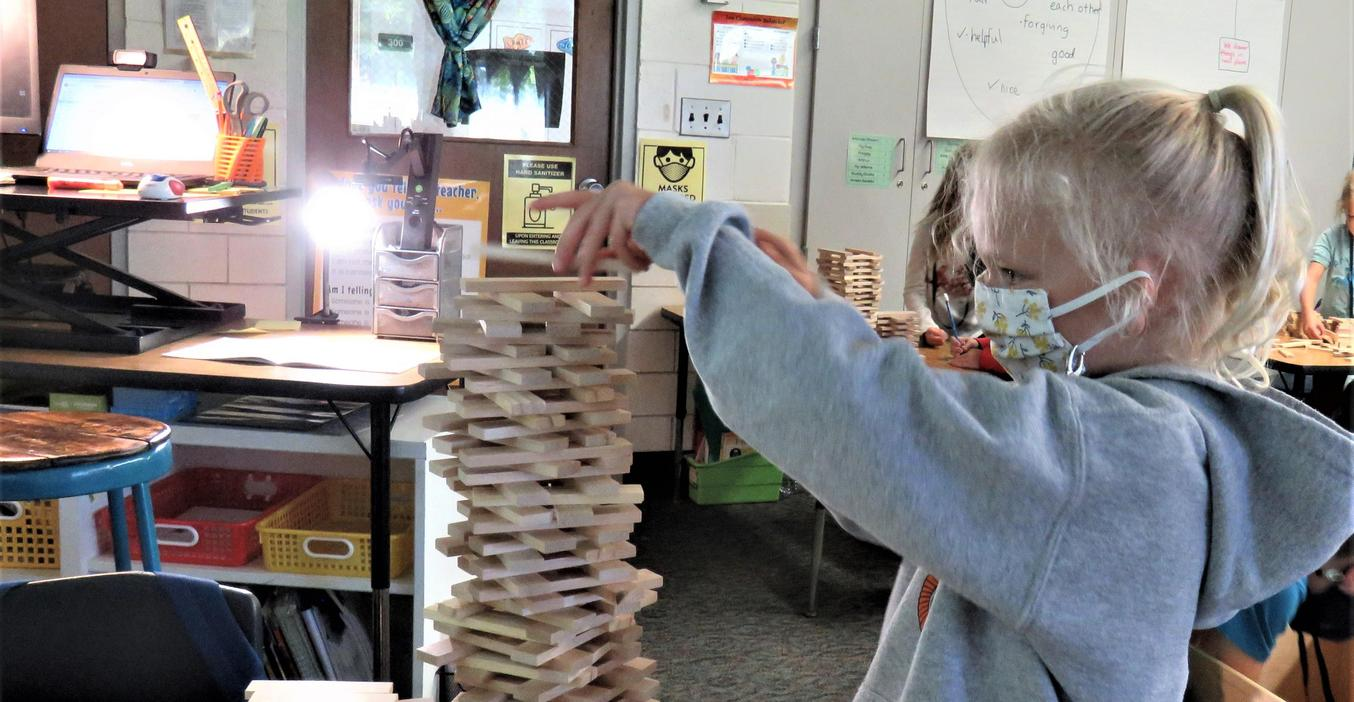 A Lee 2nd grader creates a skyscraper using Keva Planks.