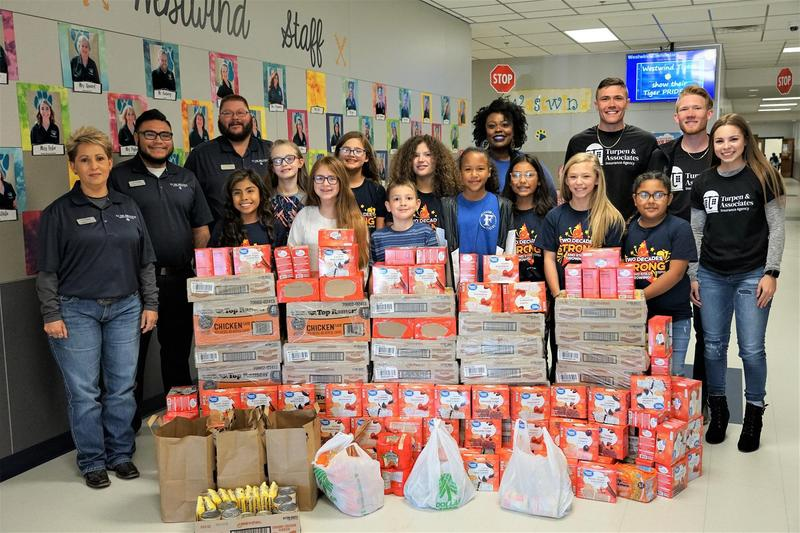 gene messer poses with student council and food donation