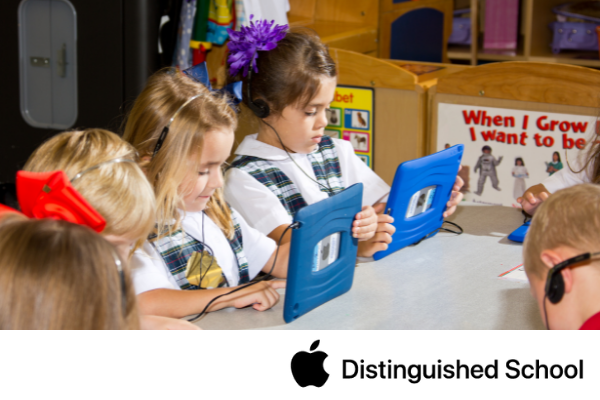 Primary group of students using their iPad.