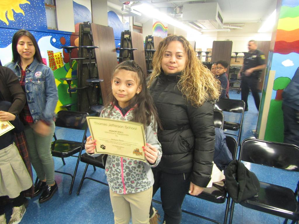mom, daughter and certificate