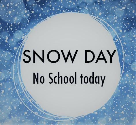 SIgn surrounded in snowflakes that says SNOW DAY No school today