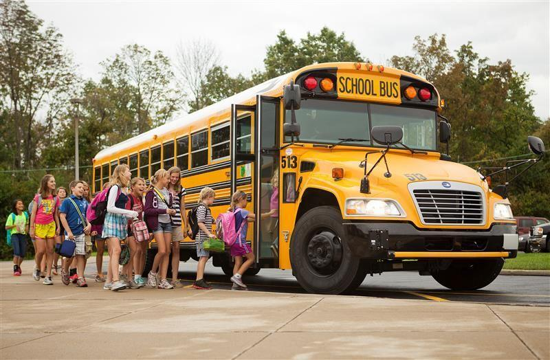 picture of students getting on a school bus