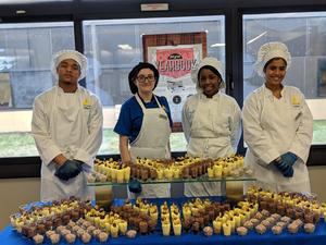 Culinary Arts students at dessert table