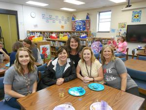 Staff celebrates with Angela Stanley.
