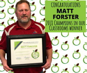 Matt Forester holding his award in a frame.