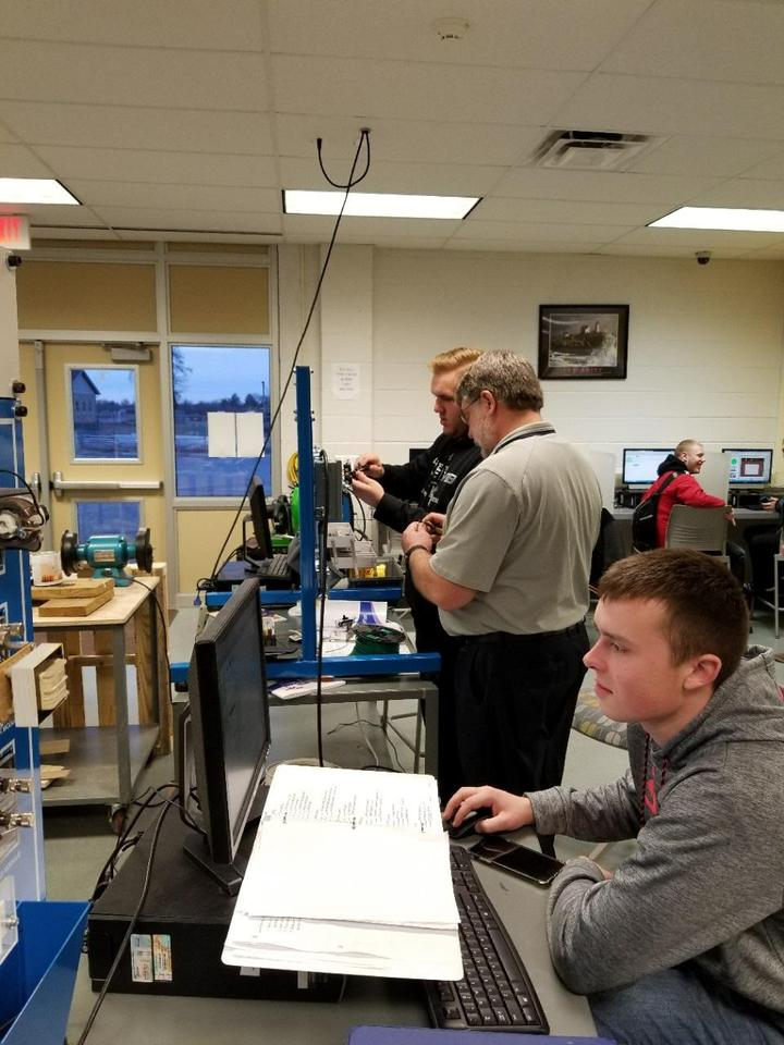 Mr. Grant and Student working in Mechatronic