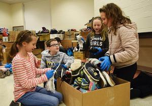 Elementary School students clean and sort shoe donations