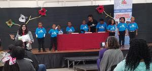 a photo of the Baker Kids' Orchestra on stage