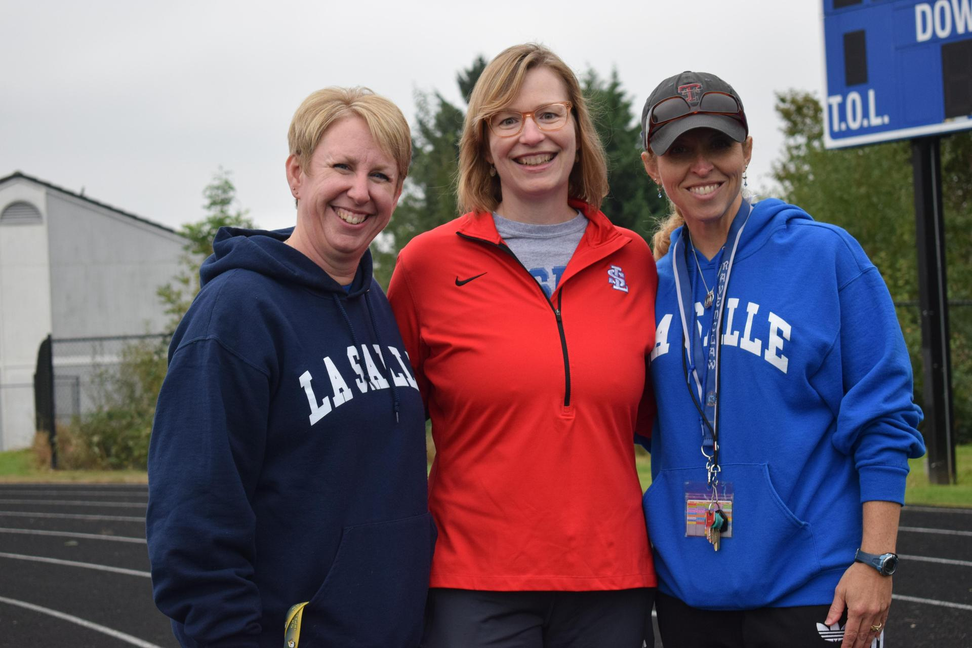staff members pose during the walk