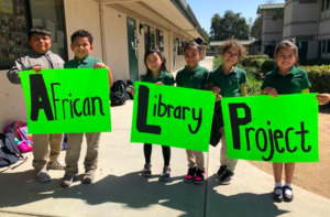 3rd Graders Pictured Fundraising for African Library Project