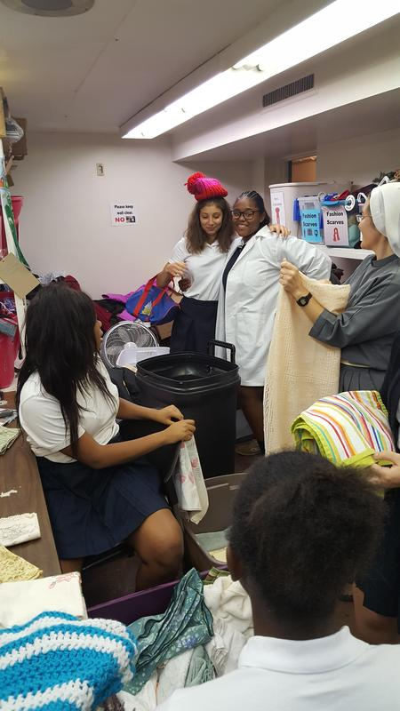 Students sort clothes at a thrift store as a service project