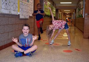 Mars Area Elementary School students complete yoga poses as they make their way through the school's new Sensory Path.