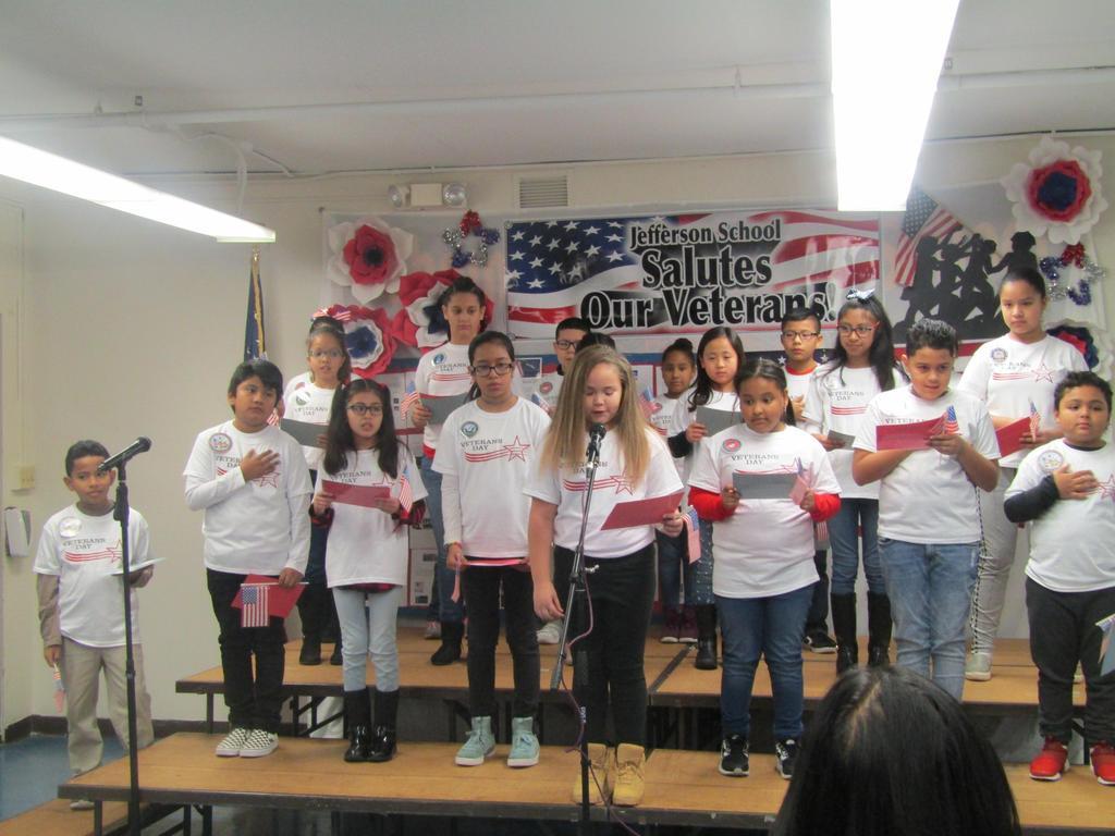 girl reading her poem to veterans