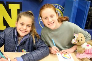 Photo of two students at Franklin School participating in Community Service Week.