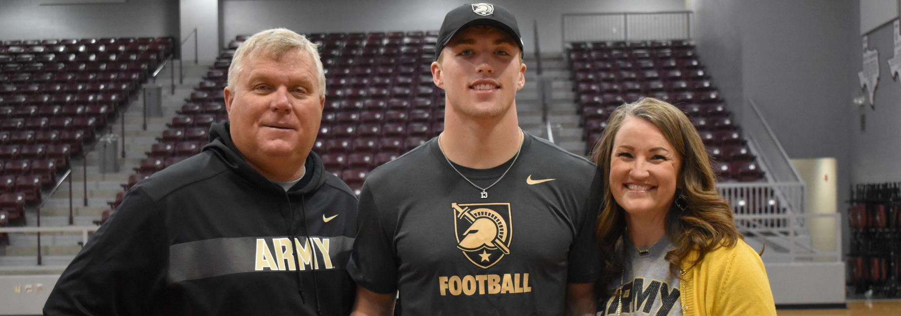The Daily Family pose together after Bryson signs with Army Football