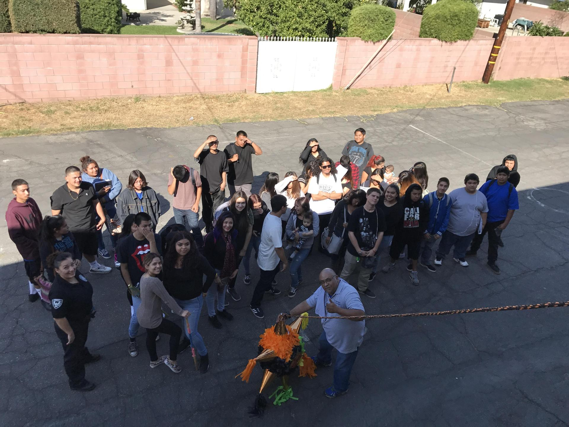 Students and staff with a piñata
