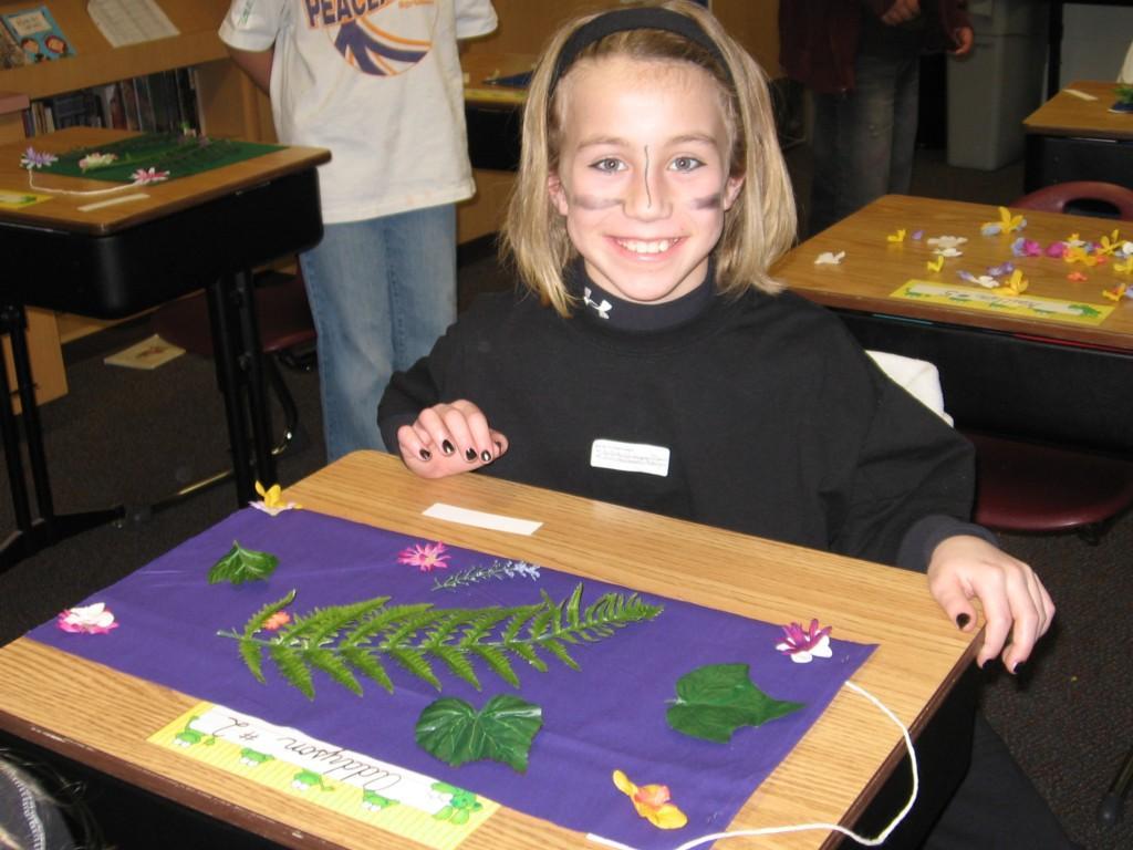 students create art at their desks