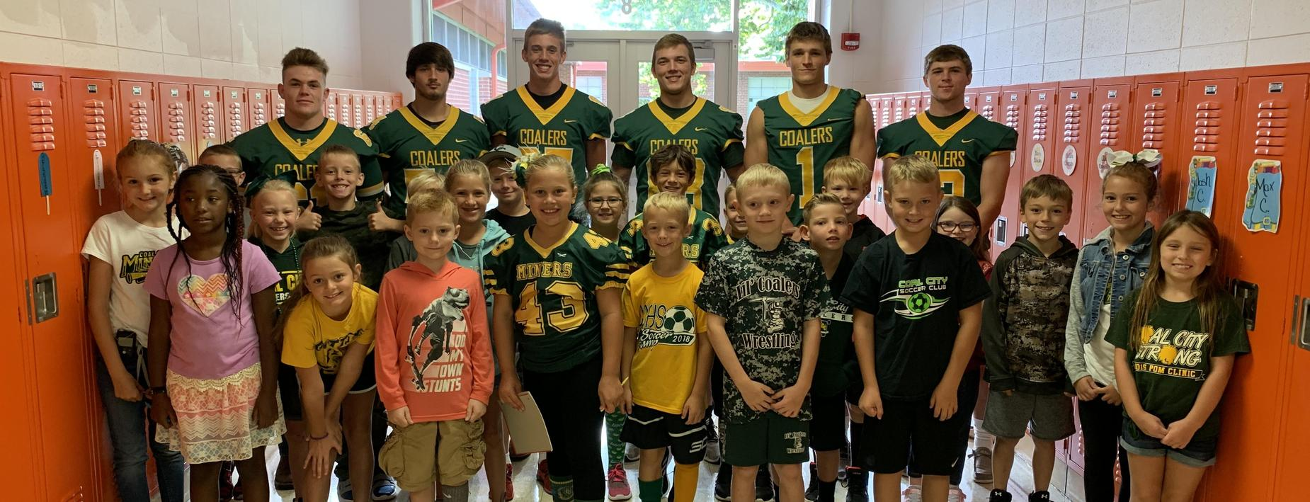 CCHS Football players meet CCES students