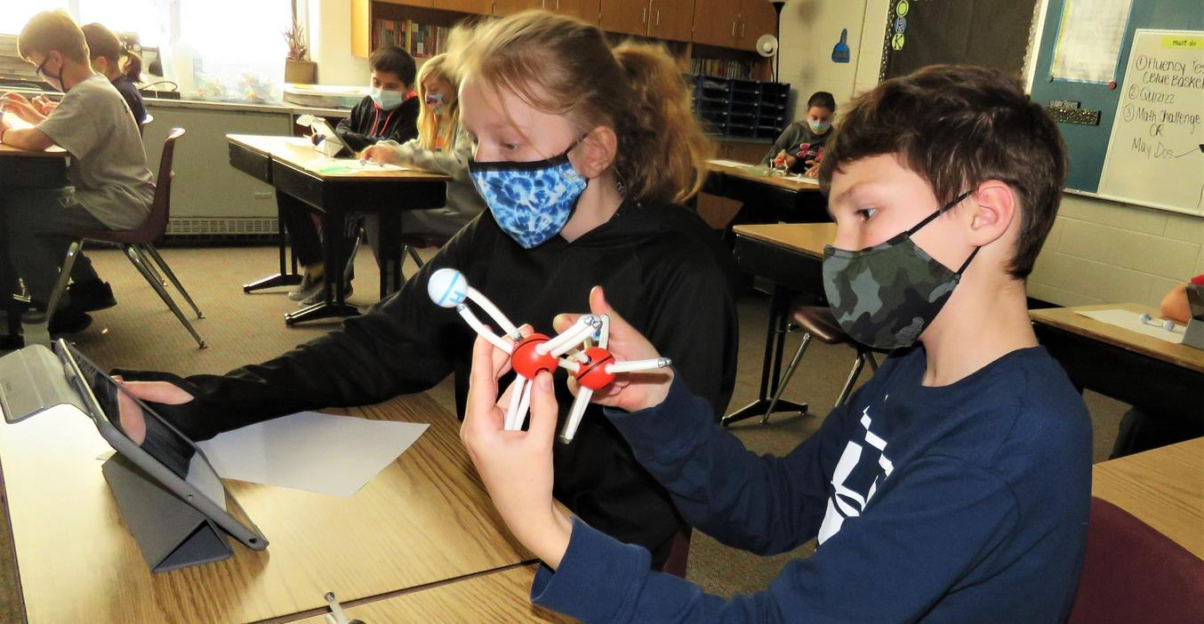 Page students build models of atoms and elements.