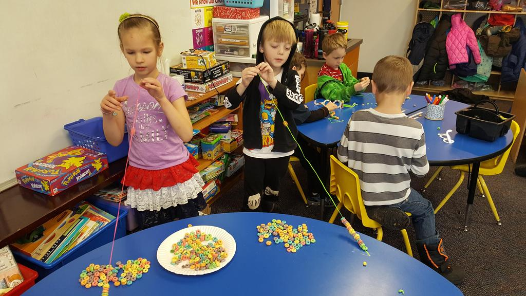 Moscow Charter School students celebrate 100 days of school threading Fruit Loops