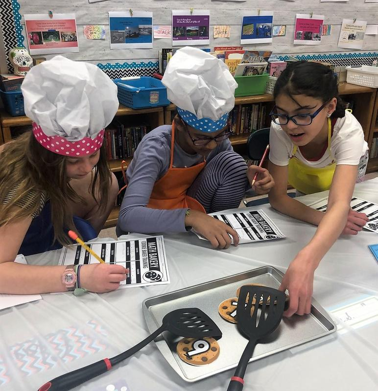 Photo of three 4th graders at Franklin School participating in a