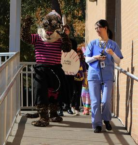 Jefferson principal Dr. Susie Hung and mascot lead the Halloween parade