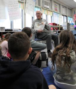 Retiree WilliamO'Herron has been volunteering in Elizabeth Reilly's class each week for the past 12 years.  He is pictured here reading to the class.