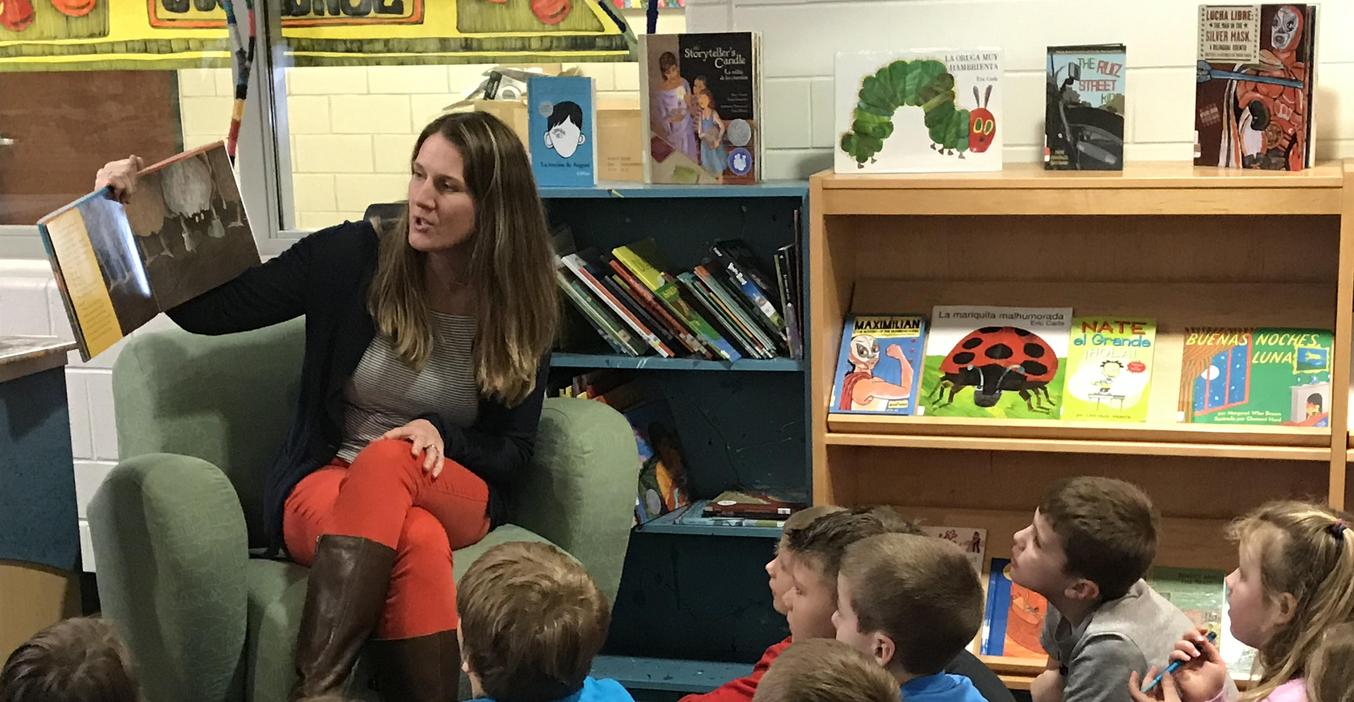 Lee Principal Angie Jefferson reads to students.