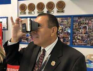 Edinburg CISD Superintendent Dr. René Gutiérrez uses a virtual reality viewer during the 7th Annual Innovate Conference at Vela High School in Edinburg.