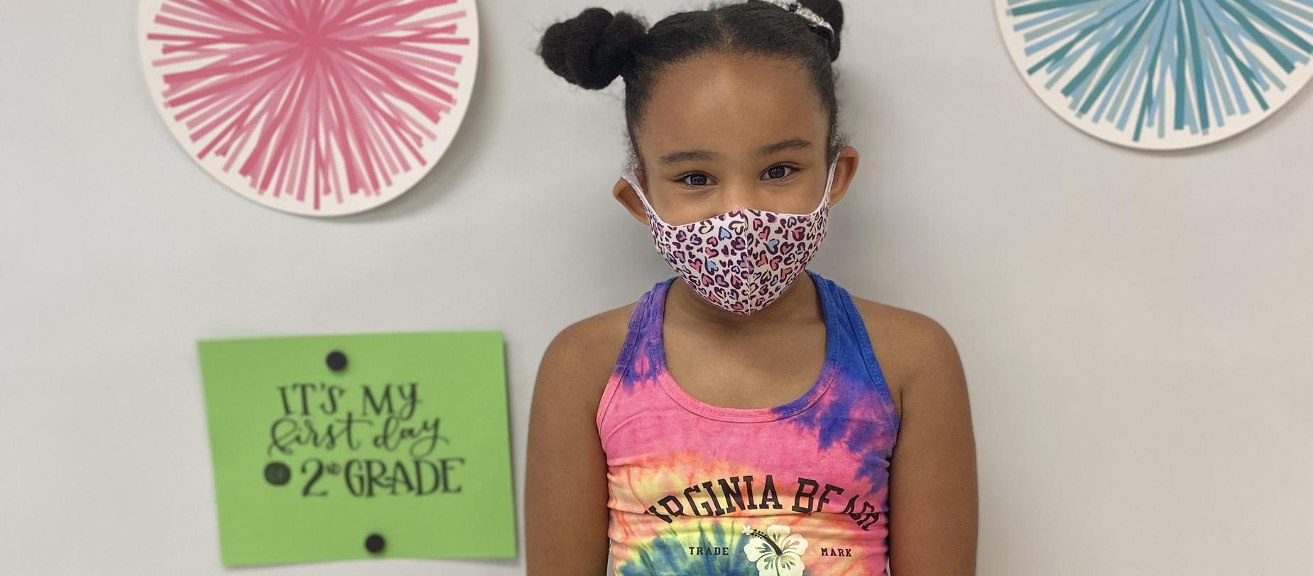 girl wearing a mask